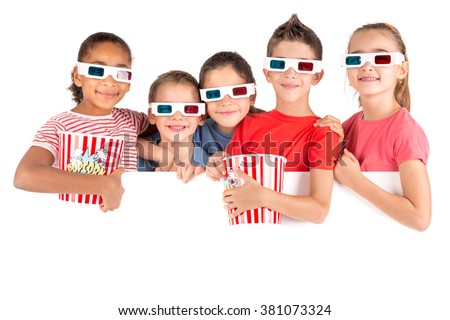 Group of children with 3d glasses and popcorn over a white board