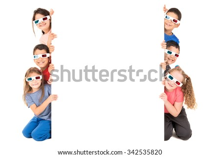 Group of children with 3d glasses over a white board - stock photo