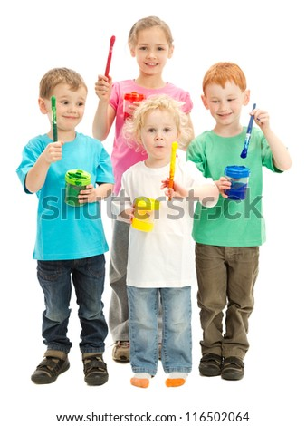 Group of children with kids paint brushes ready to paint - stock photo
