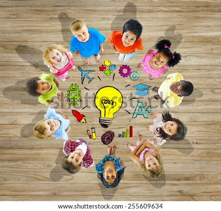 Group of Children With Light Bulb Symbol Concept - stock photo