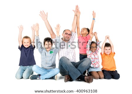 Group of children with teacher raising their arms isolated in white
