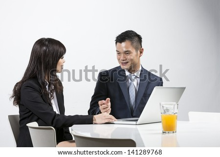 Group of Chinese business people having a meeting together - stock photo