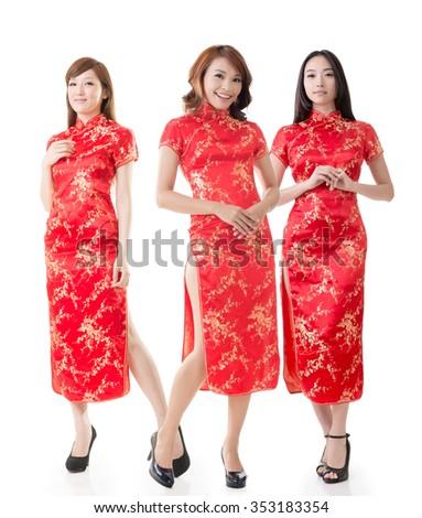 Group of Chinese women dress traditional cheongsam at New Year, studio shot isolated on white background. - stock photo