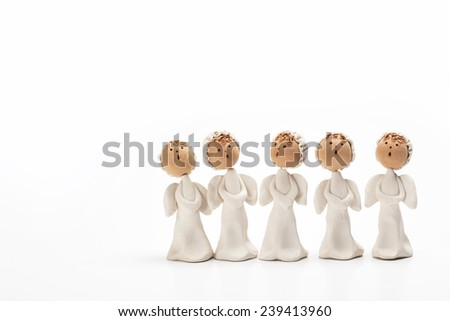 Group of Christmas carolers angel figurines - stock photo