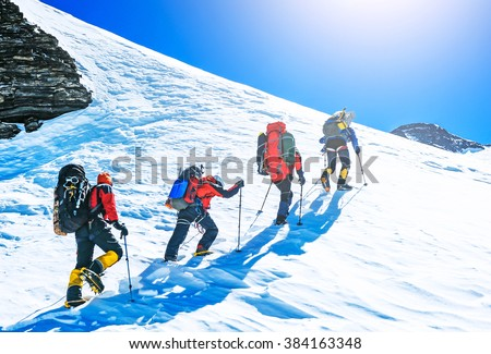 Group of climbers reaching the summit. Extreme sport - stock photo