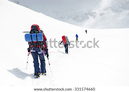 Group of  climbers reaching the summit, Nepal Himalayas
