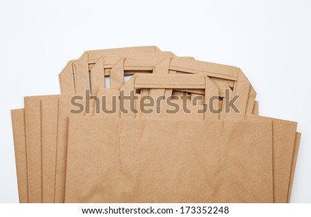 Group of closed paper shopping bags isolated on white. - stock photo