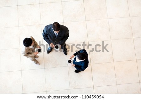 group of co-workers having coffee break at work - stock photo