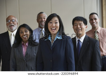 Group of co-workers laughing - stock photo