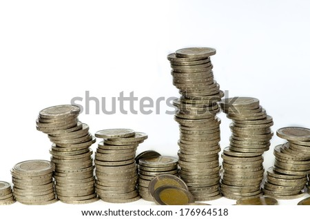 group of coins of white background - stock photo