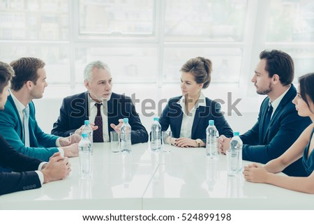 Group of colleagues planning future work at meeting in office
