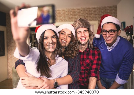 Group of colleagues taking a selfie in modern office