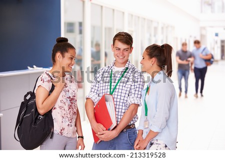 Group Of College Students Standing In Corridor - stock photo