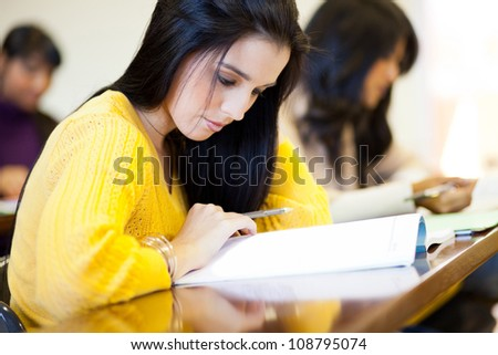 group of college students studying in classroom - stock photo
