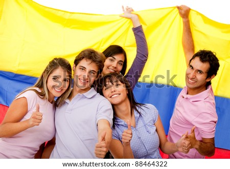 Group of Colombian friends with the flag and thumbs-up - stock photo