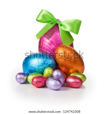 Group of colorful candy Easter eggs wrapped in foil with bow - stock photo