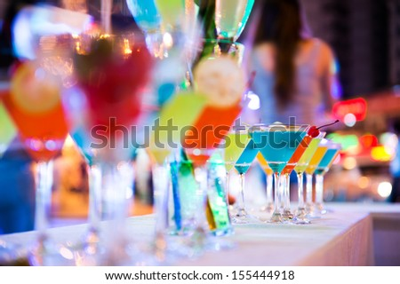 Group of colorful cocktail in martini glasses. - stock photo