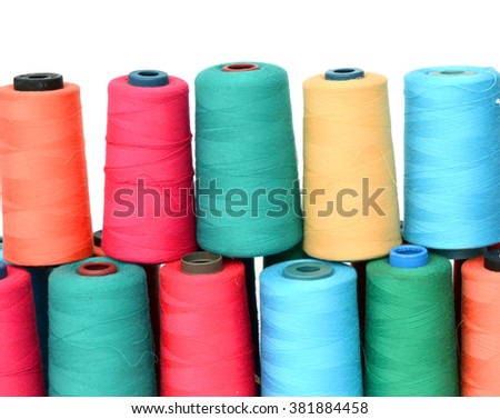 group of colorful sewing threads on white background