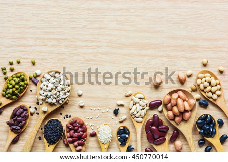 Group of colorful various beans or lentils and whole grains seeds or cereal in hemp sack and white cup. mung bean, peanut or groundnut, blackbean, red kidney bean, soybean, pinto beans, Millet. - stock photo