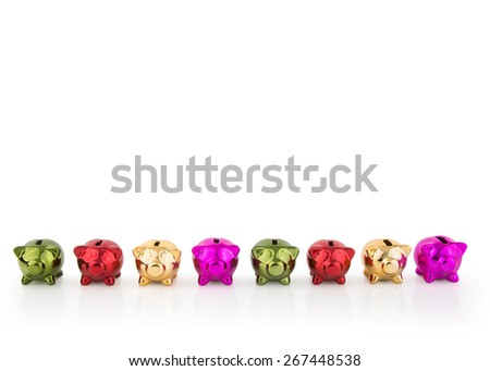 group of coloured Piggy Banks in a row - stock photo