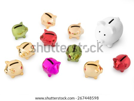 group of coloured Piggy Banks  with one white - stock photo