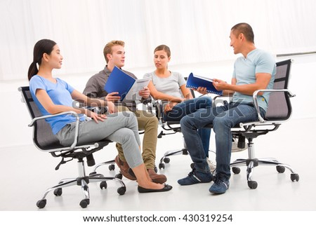 Group of confident business partners discussing paper meeting
