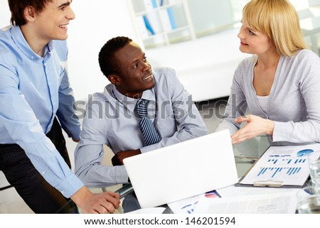 Group of confident business partners planning work and sharing ideas - stock photo