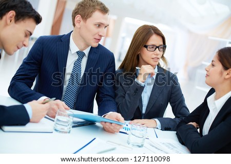 Group of confident business partners planning work at meeting - stock photo