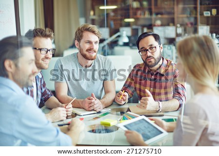 Group of confident managers listening to female employee - stock photo