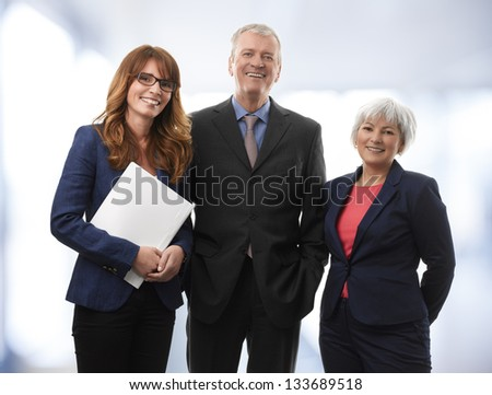 Group of confident professional managers standing in the office - stock photo