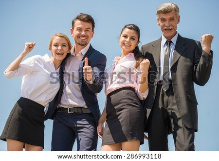 Group of confident smiling business people enjoying their success. - stock photo