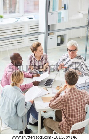 group contemporary office office building group of contemporary office workers sitting in circle during startup meeting and listening to contemporary office workers sitting circle stock photo