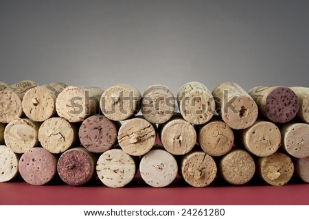 Group of corks on  red and grey background.