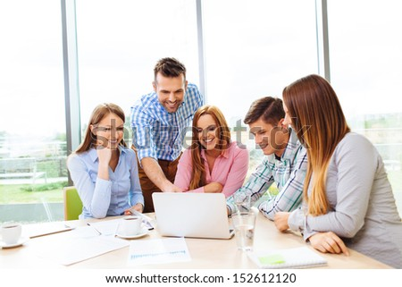 Group of corporate business people training with coach - stock photo