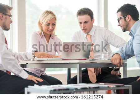 Group of corporate people by the office table