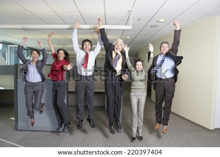 Group of coworkers jumping - stock photo