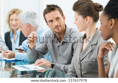 Group Of Coworkers Working In Conference Room - stock photo