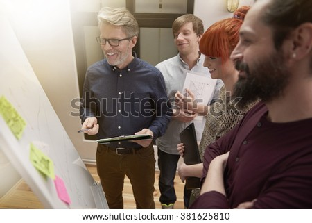Group of creative team analyzing the result of selling - stock photo