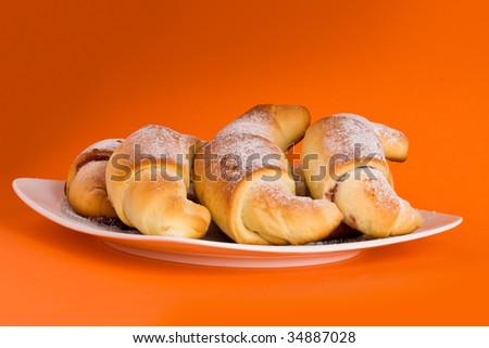 Group of croissants on square white plate