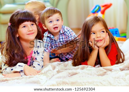 group of cute children listen attentively - stock photo