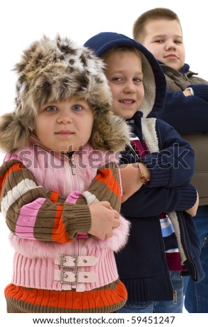 Group of 3 cute children posing together, smiling. Isolated on white background, focus on girls in the foregroud. - stock photo