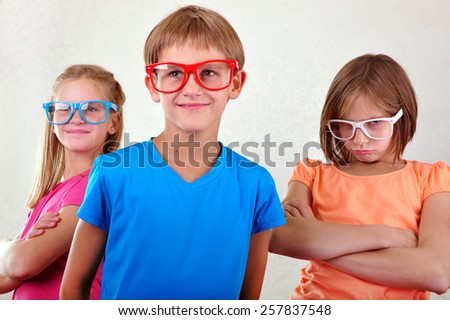group of cute funny  kids with eyeglasses posing - stock photo