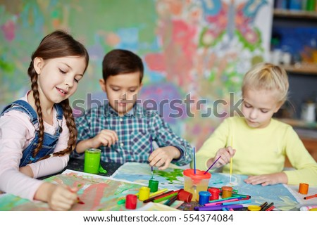 group of cute kids painting with gouache - Pictures Of Kids Painting