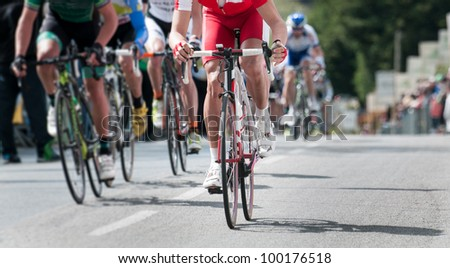 group of cyclist at professional race - stock photo