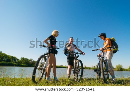 group of cyclists at sunset