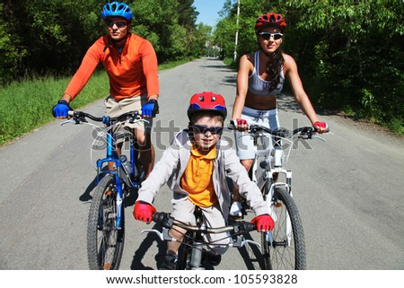 Group of cyclists following a long asphalted road - stock photo