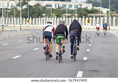 Group of cyclists  practice on the road