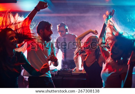 Group of dancing friends enjoying night party - stock photo