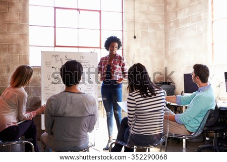 Group Of Designers Having Brainstorming Session In Office - stock photo