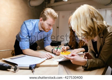 Group of designers working on a project as a team